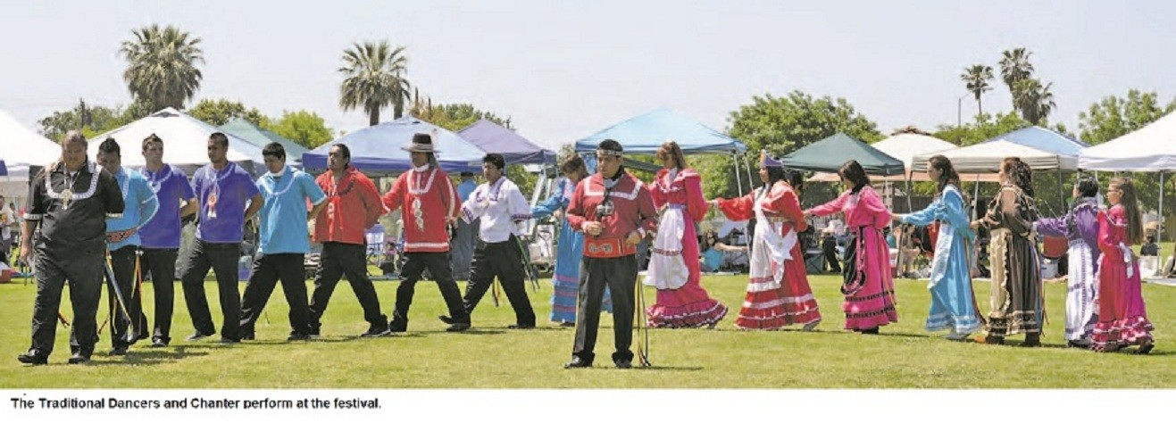 The Traditional Dancers And Chanter Perform At The Festival .